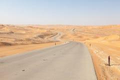 Road through the desert in Liwa Oasis Royalty Free Stock Image