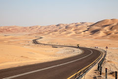 Road through the desert in Liwa Oasis Stock Photos