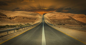 Road in desert of the Negev, Israel. Desert of the Negev is the biggest one in Israel Royalty Free Stock Photography