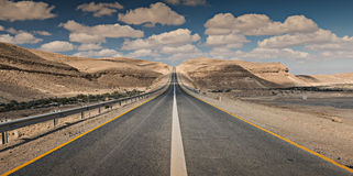 Road in desert. The photo was taken in desert of the Negev, Israel Stock Images
