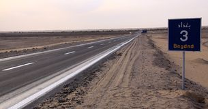 Road in desert to Bagdad. Town Stock Photo