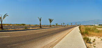 Road in the desert turns to the right Royalty Free Stock Photo