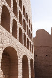 Road through the desert. Turpan ancient wall with arched windows Stock Image