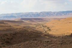 Road in desert valley. Stock Photo