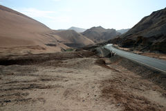 Road through a desert valley,  China Stock Photography