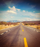 Road in desert. Vintage retro effect filtered hipster style image of travel forward concept background -  road in desert Royalty Free Stock Image