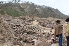 The road destroyed after melting snow. The mountain road destroyed after melting snow Royalty Free Stock Images