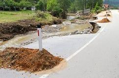 Road destruction. Rural Road Erosion Damage After Floods Royalty Free Stock Image