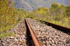 Detail of empty rails, old rails in landscape royalty free stock photo