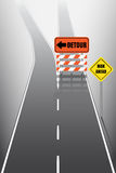 Road with detour signs. Road with detour and risk ahead signs Royalty Free Stock Photo