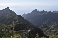 Road and difficult terrain with mountains and Ravines. In the South part of Tenerife Island Stock Image