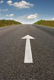 Road Direction Arrow. White Arrow on Road Pavement Pointing Forward stock image