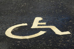 Road disable sign. Painted on the road this disable sign indicates a parking space for the disable drivers car stock image