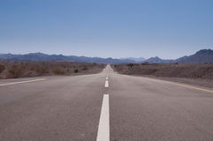 Road disappearing in distance. Empty asphalt road disappearing in distance stock photos
