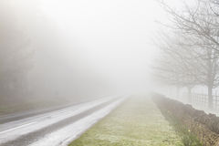 Road disappearing into fog Stock Image