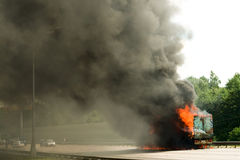 Road disaster. Big long truck in fire Stock Image