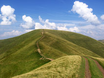 The road into the distance. Road distance route way hill mountain Stock Images