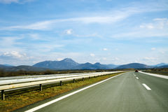 Road by the distant mountains Stock Photos