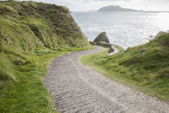 Road Down to Dunquin Harbor with Blasket Island Stock Photo