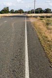 Road through dried crops Royalty Free Stock Photo