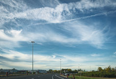 On the road. Driving shot, vehicle point-of-view, sunny day with wonderful sky Stock Image