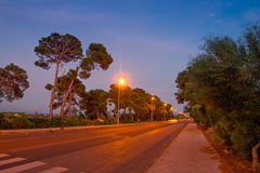 Road at dusk Stock Photography