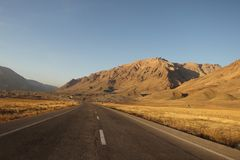 The road in East Azerbaijan Province on sunset, Iran. The hills and mountains of the province are divided into three ranges: the Qara Daq Mountains, the Sahand Stock Image