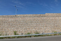 Road embankment of gravel reinforced with steel mesh Royalty Free Stock Image