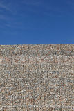 Road embankment of gravel reinforced with steel mesh Stock Photography