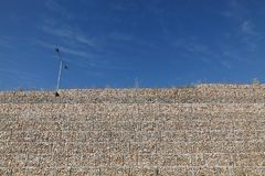 Road embankment of gravel reinforced with steel mesh Stock Images