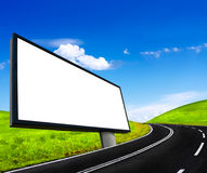 Road and empty billboard. On blue sky Royalty Free Stock Photo