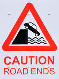 Road Ends Sign. Detail of a British Street Sign Warning of Road Ending at a Habour Stock Photo
