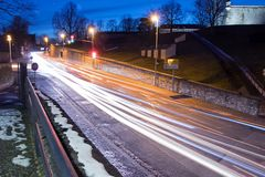 Road in Erfurt at night with car lights and lantern stock photography