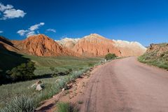 Road and eroded mountains in Kyrgyzstan. Road and eroded mountains, Tien Shan, Kyrgyzstan Royalty Free Stock Image