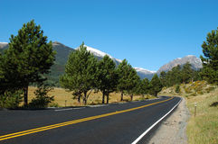 A road in Estes Park. Rocky Mountain National Park is located in the north-central region of the U.S. state of Colorado. It features majestic mountain views, a stock photography