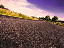 Road in evening time Stock Images