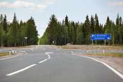 Road exit and direction sign are on the Kola route. The Kola route is federal highway from St. Petersburg to Murmansk Stock Image