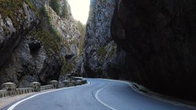 Road at the famous romanian canyon Cheile Bicazului stock video footage