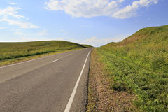 Road among farm fields. Altai Krai in Russia Stock Photos