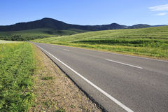 Road among farm fields Royalty Free Stock Photography
