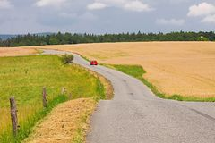 Road through farmlands. Narrow road through agricultural fields Stock Image