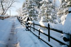 The road between the fences during wintertime is seen in Zakopane Royalty Free Stock Image