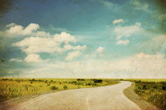 Road in a field. Old grungy illustration Royalty Free Stock Image
