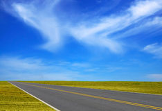 Road through field. With beauty sky Royalty Free Stock Images