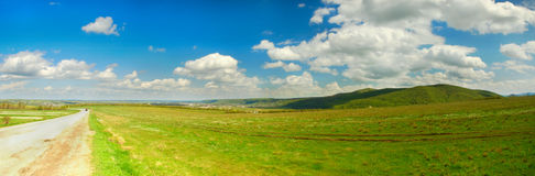 Road in field. Near mountains, Ukraine Royalty Free Stock Images