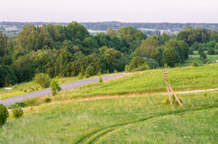 Road and field with forest. Old wooden pole royalty free stock images