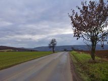 Road in the field in november Royalty Free Stock Photography