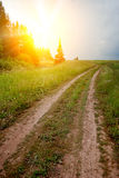 Road in field over sunset Stock Photos