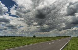 Road, field and sky Royalty Free Stock Photography