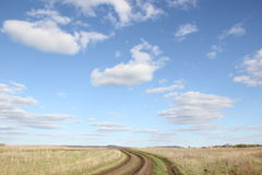 Road in field Royalty Free Stock Photos